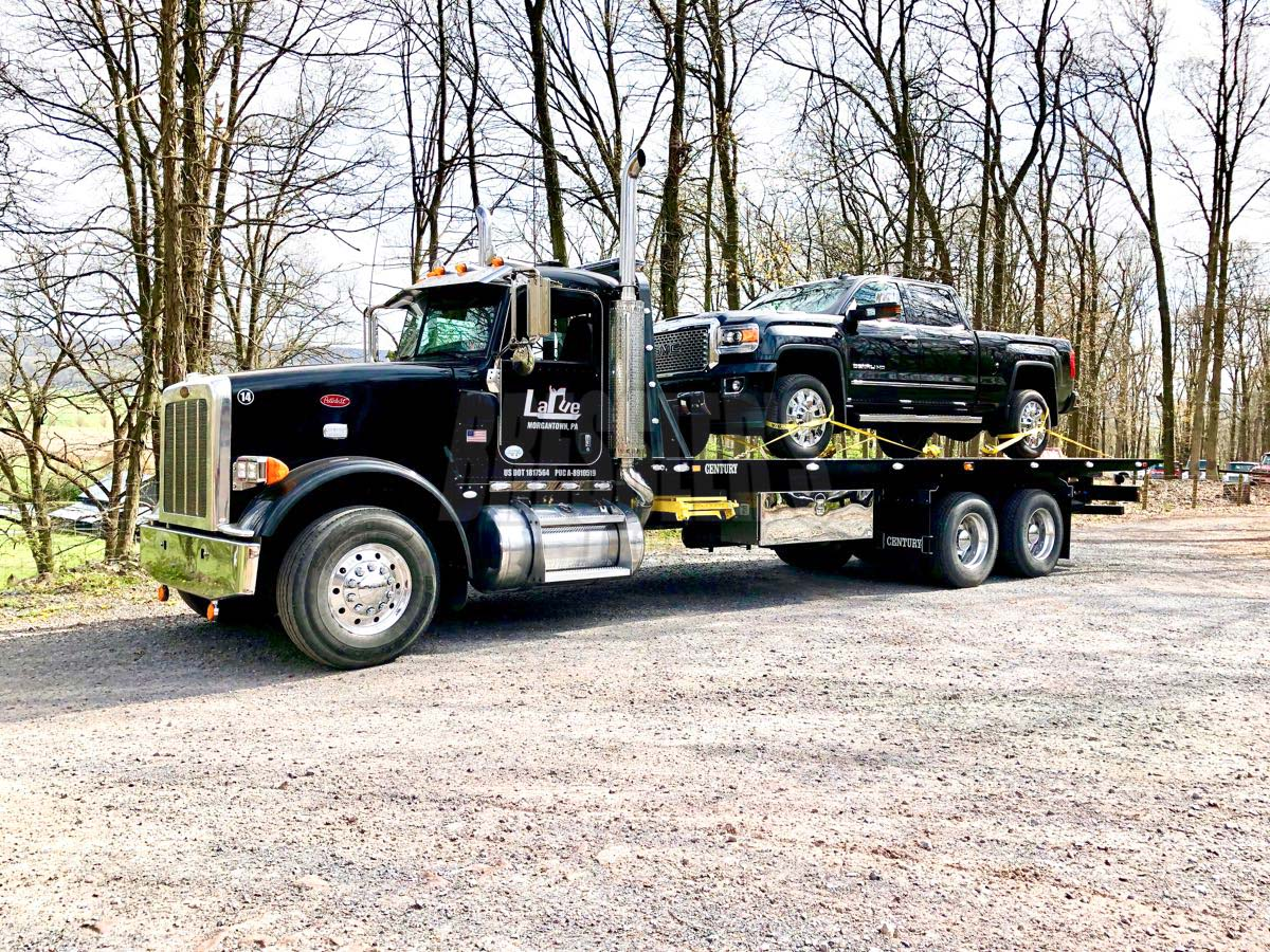 Black Peterbilt 367 Century Industrial Carrier