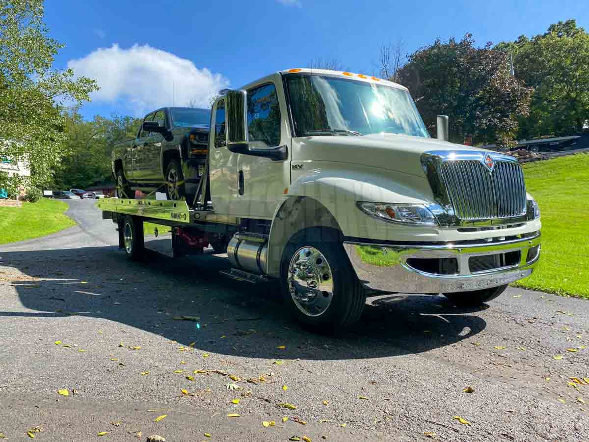 International MV Extended Cab Century Aluminum Carrier