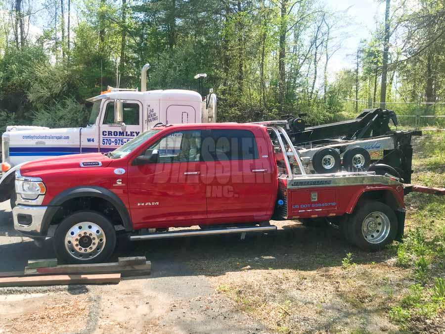Red Ram 5500 crew cab Jerr Dan wrecker remount by Bressler's Inc.