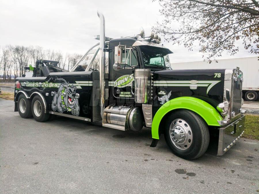 Black Peterbilt 379 Century 5130 short wheelbase wrecker